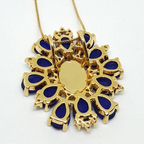 verso medalha do colar de nossa senhora das gracas cristais azuis brilho folheados