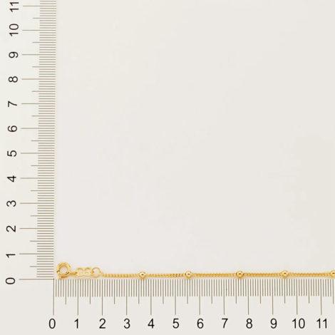 Imagem de fundo cinza contendo bordas com régua, medindo a espessura da pulseira de bolinhas infantil da Rommanel. SKU 550104.