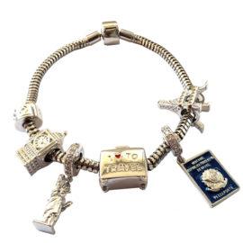 pulseira berloqueira 18cm com 6 berloques tema de viagem ferias marca