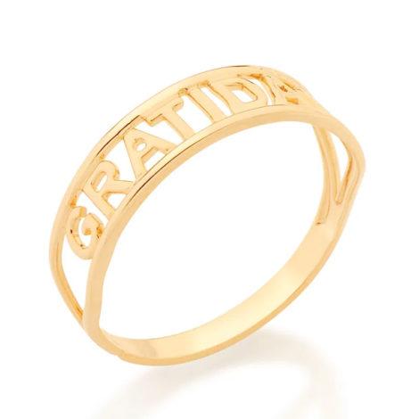 Imagem de fundo branco com um anel no centro da marca Rommanel, código 512850. Anel na cor dourada folheado a ouro, anel skinny ring duplo aro escrito gratidão no centro.